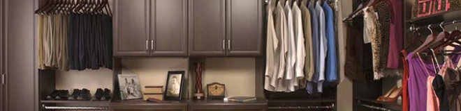 walk in closet with mahogany finish